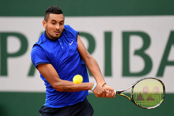 Nick Kyrgios hits a backhand at the French Open in Paris/Getty Images