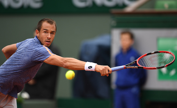 Rosol stretches as far as possible to reach the Wawrinka serve. Credit:
