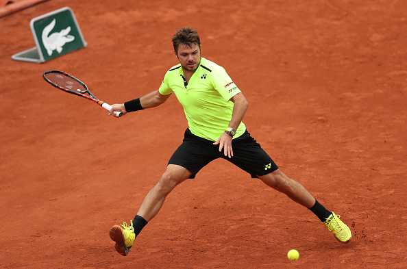 Wawrinka tracks down the shot before ripping the forehand. Credit: Ian MacNicol/Getty Images