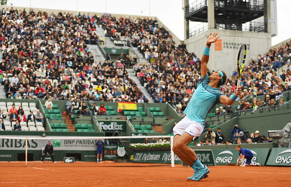 Rafael Nadal serves at the French Open in Paris/Getty Images
