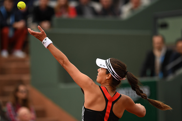 Ana Ivanovic tosses a serve at the French Open in Paris/Getty Images
