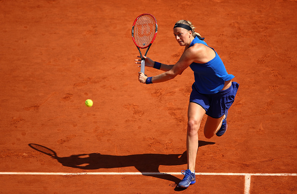 Kvitova plays a backhand in her match against Hsieh Wednesday. Photo credit: Clive Brunskill/Getty Images.