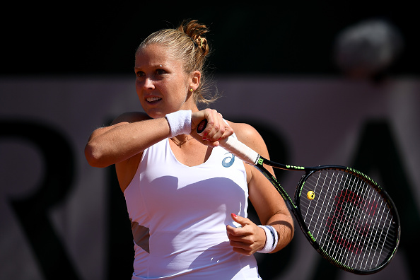 Rogers returns a forehand to Vesnina in their second round clash. Photo credit: Dennis Grombkowski/Getty Images.