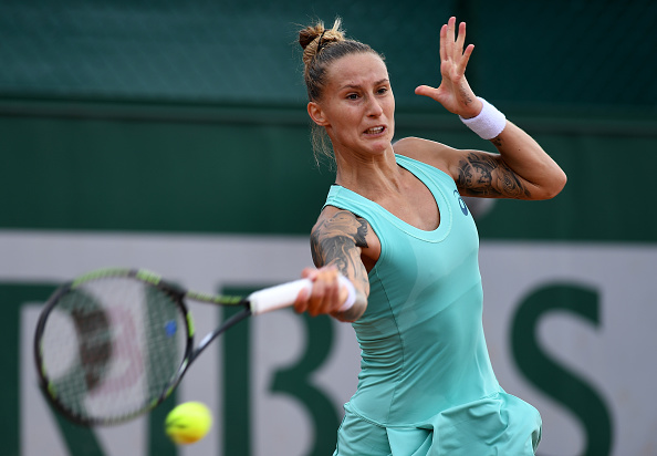 Hercog takes the lead in the first set with her attacking display | Photo: Dennis Grombkowski/Getty Images