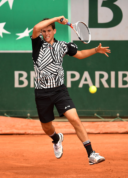 Dominic Thiem of Austria hits a forehand during the Men's Singles second round match against Guillermo Garcia-Lopez. (Photo by Clive Brunskill/Getty Images)