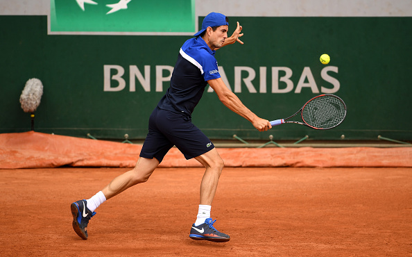 Guillermo Garcia-Lopez of Spain plays a backhand against Dominic Thiem at Roland Garros. (Photo by Dennis Grombkowski/Getty Images)