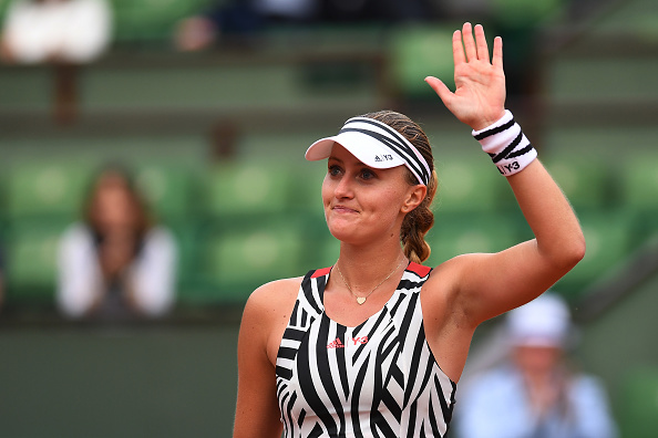 Kristina Mladenovic waves to her home crowd on Philippe Chatrier after her second round win over Timea Babos (Getty/Dennis Grombkowski)