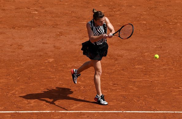 Simona Halep hits a backhand at the French Open in Paris/Getty Images