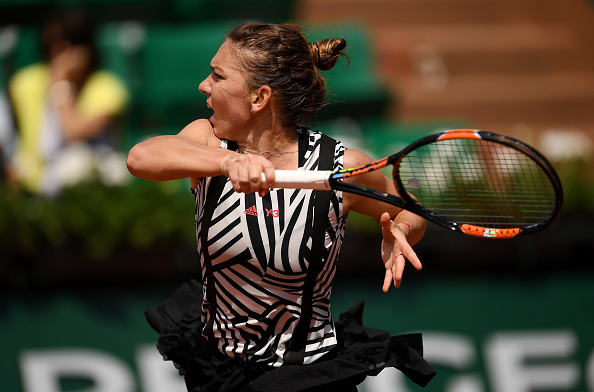 Simona Halep hits a forehand at the French Open in Paris/Getty Images