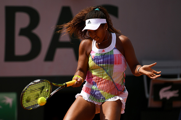 Naomi Osaka hits a forehand at the French Open in Paris/Getty Images