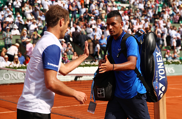Richard Gasquet shakes hands with a dejected Nick Kyrgios (Photo: Clive Brunskill/Getty Images)