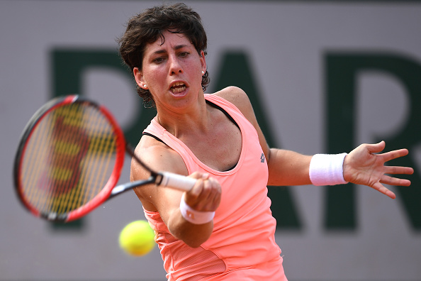 Carla Suarez Navarro hits a forehand at the French Open in Paris/Getty Images
