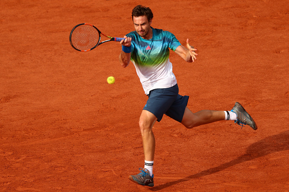 Ernests Gulbis hitting a forehand shot (Photo: Julian Finney/Getty Images)