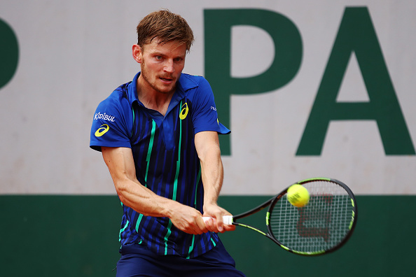 David Goffin hits a backhand during his third round match against Nicolas Almagro at the French Open. (Photo by Clive Brunskill/Getty Images)