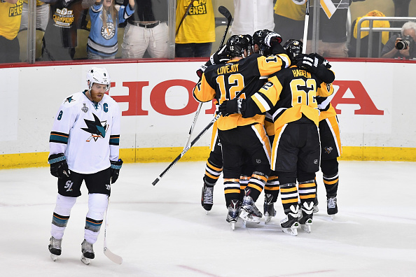 Nick Bonino is mobbed by his teammates after scoring the eventual game-winning goal with 2:33 left in regulation/Photo: Jamie Sabau/Getty Images