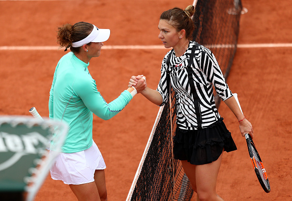 Halep failed to ignite her game in dank conditions (photo:getty)