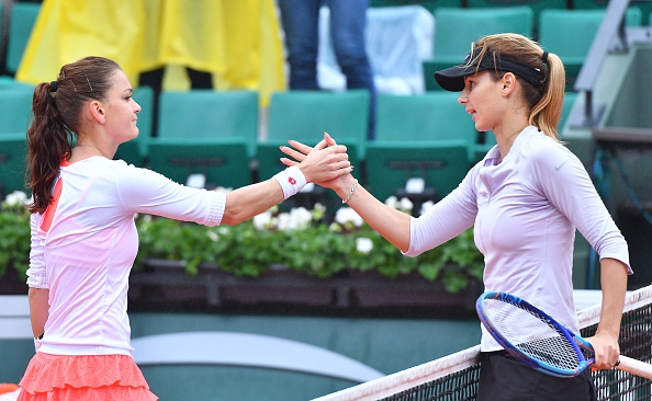 Tsvetana Pironkova (R) celebrates her victory after winning the match against Agnieszka Radwanska (R) during the women's single fourth round match at the French Open. (Photo by Mustafa Yalcin/Anadolu Agency/Getty Images)