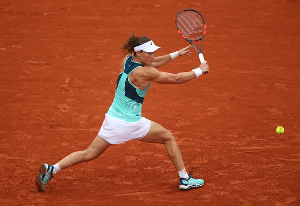 Samantha Stosur slides into a backhand at the French Open in Paris/Getty Images