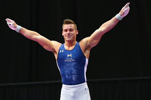 Sam Mikulak salutes after a routine at the P&G Men's Gymnastics Championships in Hartford/Getty Images