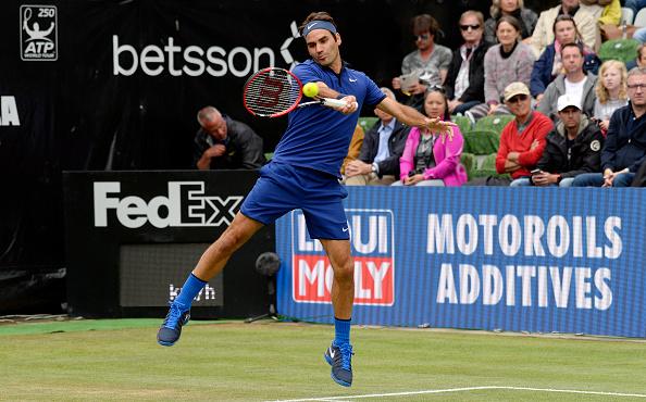 Federer crushes a forehand return for a winner. Credit: Daniel Kopatsch/Getty Images