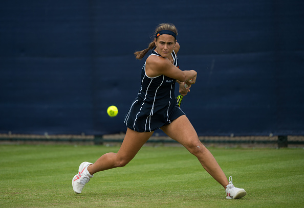 As with the first set, Puig raced out to a quick 3-0 lead, only to see Paszek recover to level the set before the Puerto Rican closed strong to capture the match/Photo Source: Jon Buckle/Getty Images