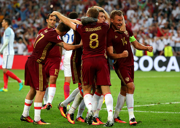 Russia celebrate their last gasp equaliser. (Photo: Alex Livesey/Getty Images)