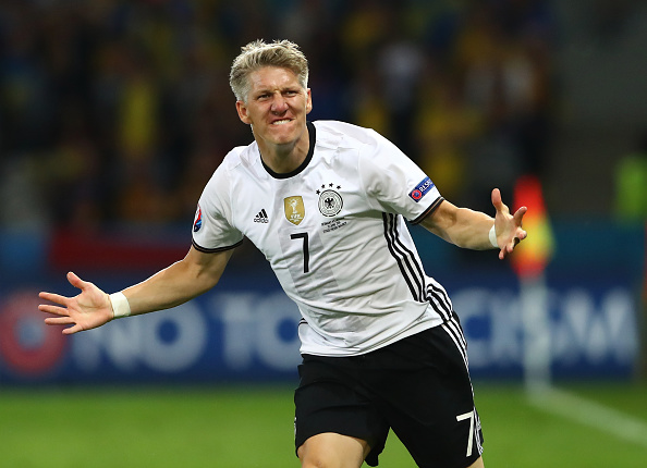 ... And is celebrating his 24th goal for Germany just moments later. (Photo: Alexander Hassenstein/Getty Images)