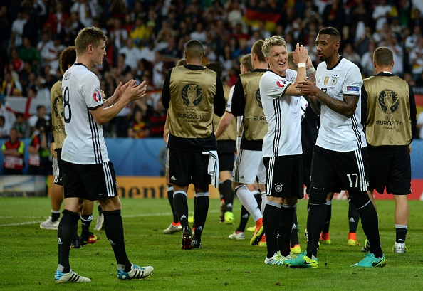 Germany celebrate after clinching all three points. (Photo: FRANCOIS LO PRESTI/AFP/Getty Images)