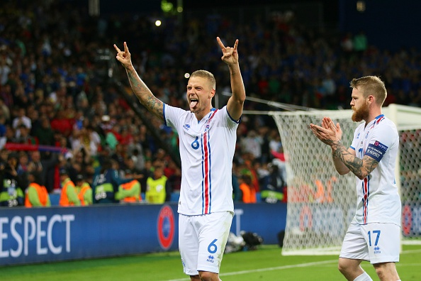 Iceland celebrate their historic point against Portugal. (Photo: Evren Atalay/Anadolu Agency/Getty Images)