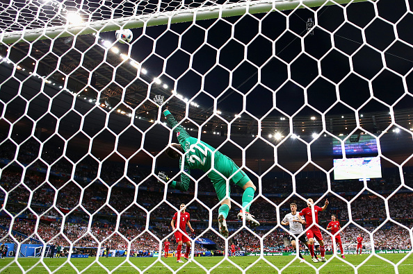 Lukasz Fabianski makes a flying save as he preserves his clean sheet against Germany. (Photo: Paul Gilham/Getty Images)