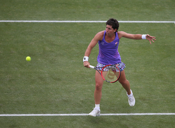 Suárez Navarro's backhand was a sight to behold as she breaks first in the third set | Photo: Steve Bardens/Getty Images