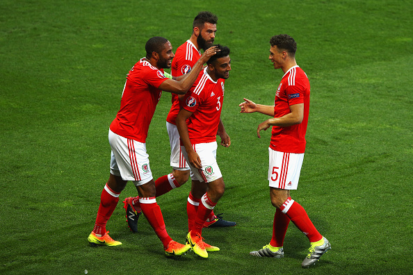 Neil Taylor is congratulated by Ashley Williams, as well as James Chester and Joe Ledley, as he scores against Russia. (Photo: Ian Walton/Getty Images)