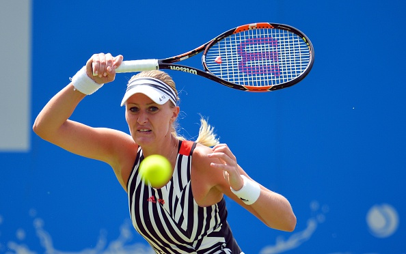 Mladenovic surges ahead in the first set | Photo: Glyn Kirk/Getty Images