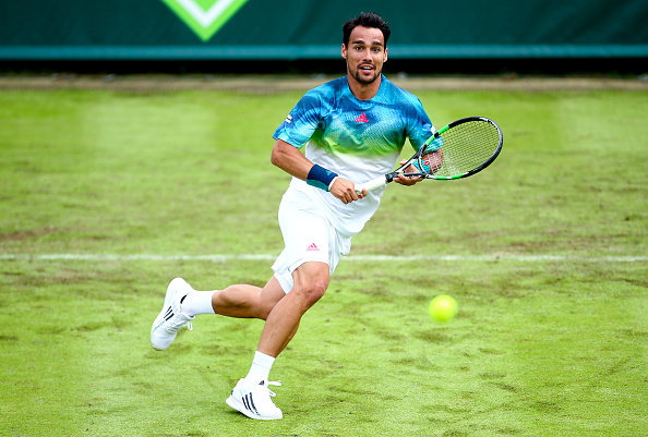 Fabio Fognini hits a volley at The Boodles at Stoke Park in London/Getty Images