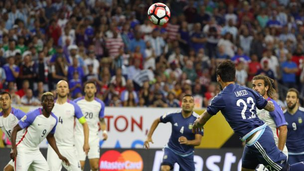 Ezequiel Lavezzi (Center) preparing to head in the first goal as the American defense watches on Tuesday at NRG Stadium. Photo provided by Getty Images.