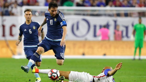 Lionel Messi (Center) eluding another American tackle on Tuesday semifinal clash. Photo provided by Getty Images.