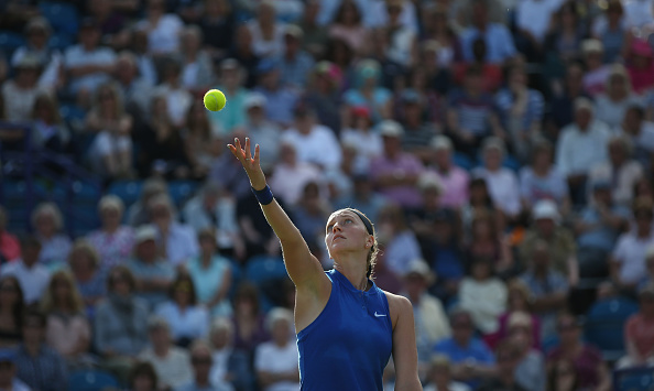 Petra Kvitova tosses the ball up to serve during her third round match against Johanna Konta. (Photo by Steve Bardens/Getty Images for LTA)