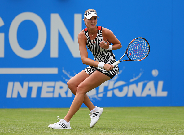 Mladenovic finds the first break | Photo: Steve Bardens/Getty Images