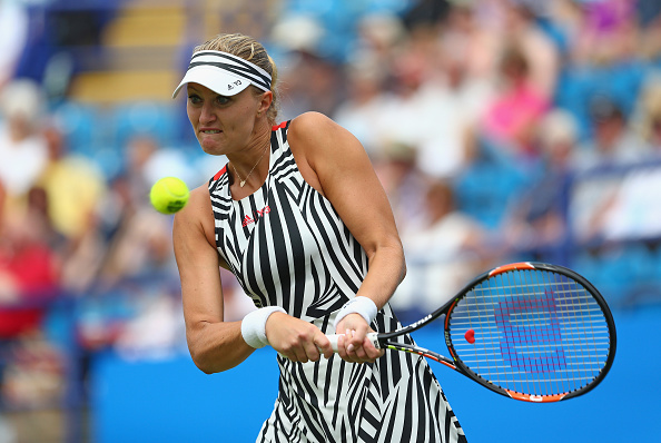 Mladenovic races ahead in the second set | Photo: Steve Bardens/Getty Images