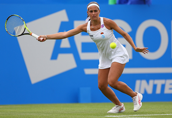 Puig keeps pegging the Frenchwoman back and closes out set in tiebreak | Photo: Steve Bardens/Getty Images