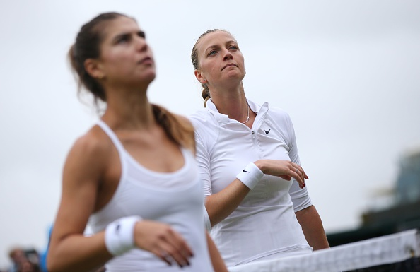 Cirstea (left) and Kvitova after their handshake at the net. Photo credit: Justin Tallis/Getty Images.