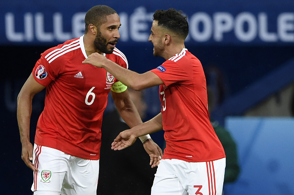 Ashley Williams and Neil Taylor celebrate after the former's goal. (Photo: MIGUEL MEDINA/AFP/Getty Images)