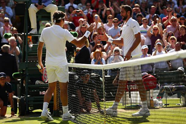 Roger Federer and Marin Cilic meet after their five-set quarterfinal encounter last year (Getty/Clive Brunskill)