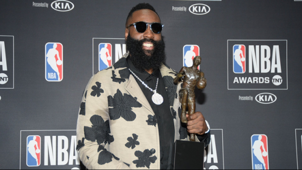 Houston Rockets guard James Harden poses for photos with his MVP award. |Gary A. Vasquez-USA TODAY Sports|