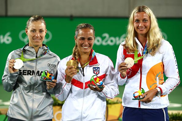 Kvitova with fellow Olympic medal winners, silver medallist Angelique Kerber (left) and gold medallist Monica Puig (centre) after the conclusion of the final at this year's Rio Olympics. Photo credit: Clive Brunskill/Getty Images.