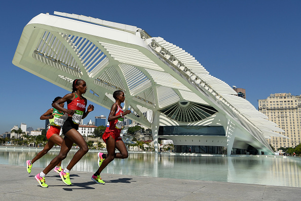 The athletes running their final meters in front of the Future museum. Dibaba ,Gumgong and Kirwa were the ones to change their pace in order to reach the podium. Photo:Getty/Matthias Hangst