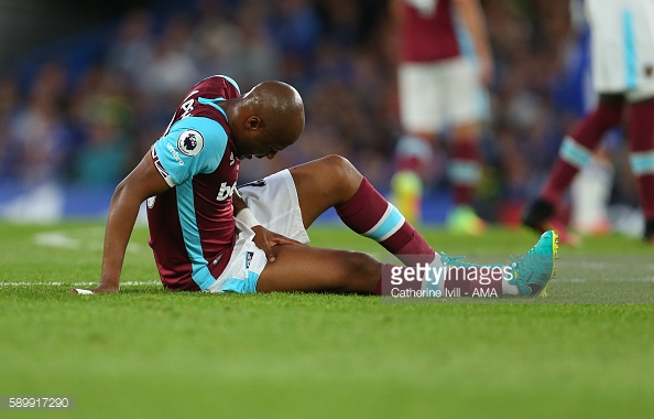 Above: Andre Ayew down injured in West Ham's opening day defeat to Chelsea | Photo: Getty Images