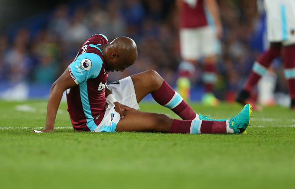 Andre Ayew lying injured on the pitch in West Ham's 2-1 defeat to Chelsea | Photo: Getty Images
