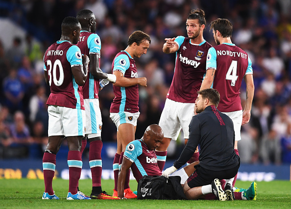 Above: Andre Ayew laying injured on the Stamford Bridge after West Ham's 2-1 defeat to Chelsea |Photo: Getty Images