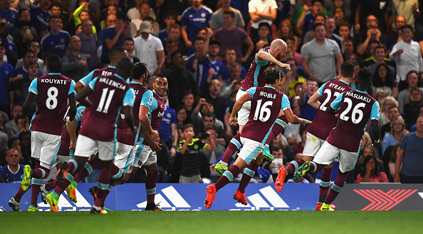 Above: James Collins celebrating his goal in West Ham's 2-1 defeat to Chelsea | Photo: Getty Images
